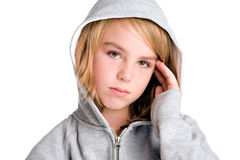 Young girl looking a little shy at the viewer Stock Photo