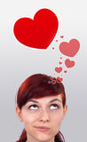 Young girl looking at love type of icons stock images