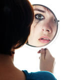Young girl looking in the mirror. And crying - sensitive eyes Stock Photography