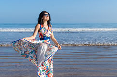 Young girl looking at the ocean and city Royalty Free Stock Photography