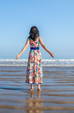 Young girl looking at the ocean and city Royalty Free Stock Photo