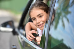 Young girl looking out the car window Royalty Free Stock Photography