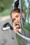 Young girl looking out the car window Royalty Free Stock Image