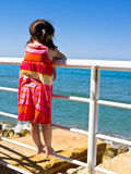 A young girl looking out to sea Royalty Free Stock Images