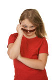 Young girl looking over sunglasses Royalty Free Stock Photography