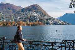 Young girl looking at the panoramic scenery. Lugano, Switzerland Royalty Free Stock Photo