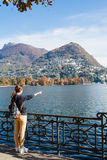 Young girl looking and pointing at the panoramic scenery. Lugano Stock Images