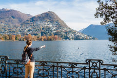 Young girl looking and pointing at the panoramic scenery. Lugano Stock Photography