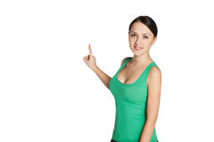 Young girl looking, pointing and smiling. Stock Photography