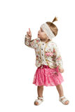 Young girl looking and pointing up at corner Stock Photography