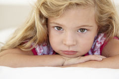 Young Girl Looking Sad On Bed In Bedroom Stock Image