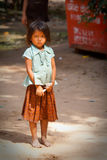 Young girl looking sad begging. Child living in poverty in Cambodia Royalty Free Stock Photo
