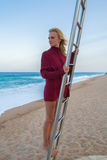 Young girl  looking into the sea. From baywatch tower Stock Photo