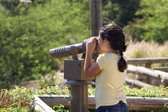 Young girl looking through telescope Royalty Free Stock Image