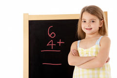 Young Girl Looking Thoughtful Next To Blackboard Royalty Free Stock Photo