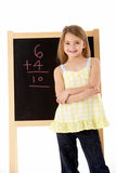 Young Girl Looking Thoughtful Next To Blackboard Royalty Free Stock Photos
