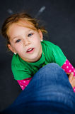 Young girl looking to the sky Stock Photography