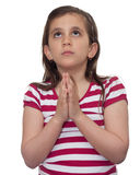 Young girl looking up and praying stock photography