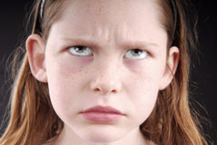 Young girl looking upset Royalty Free Stock Photos