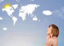 Young girl looking at world clouds and sun on blue sky Stock Images