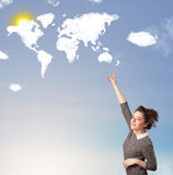 Young girl looking at world clouds and sun on blue sky Royalty Free Stock Images
