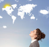 Young girl looking at world clouds and sun on blue sky Stock Photography