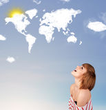 Young girl looking at world clouds and sun on blue sky Royalty Free Stock Image