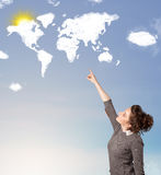 Young girl looking at world clouds and sun on blue sky Royalty Free Stock Photography