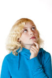 Young girl looks contemplative in the air Stock Photo