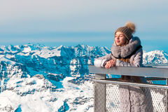A young girl looks at the mountains and resting Stock Photos