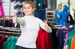 Young girl looks satisfied in the fashion shop royalty free stock photos