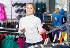 Young girl looks satisfied in the fashion shop Stock Images