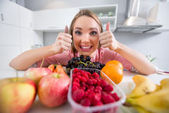 Young girl with lot of fruits Stock Image