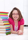 Young girl with lots of books Royalty Free Stock Images