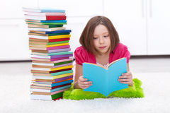 Young girl with lots of books Stock Photos