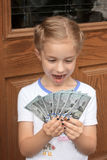 Young Girl with Lots of Money Royalty Free Stock Photo