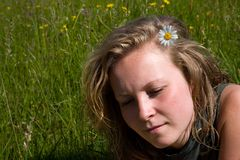 Young girl in love. Laying in the meadow stock photography