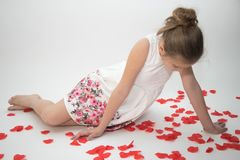 Young girl in love looking down thoughtfully. A photograph of a young girl in love looking down thoughtfully,  isolated white background Royalty Free Stock Photo