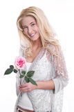 Young girl in love with a rose. In hand, isolated on white Stock Photography