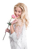 Young girl in love with a rose. In hand, isolated on white Stock Images