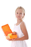Young girl with lunchbox containing apples Royalty Free Stock Image