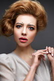 Young girl with lush hairstyle and make-up Nude. Beautiful model with sequins on the eyebrows and gentle pink manicure. The beauty of the face. The photo was Royalty Free Stock Images