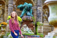 Young girl in the Luxembourg garden of Paris. Young beautiful girl in the Luxembourg garden of Paris royalty free stock photo