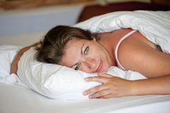 Young girl luxuriating in bed Stock Image