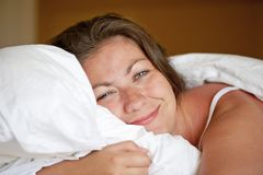 Young girl luxuriating in bed  morning Stock Image