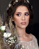 Young girl in a luxurious wedding dress. Portrait of the bride with a bouquet.