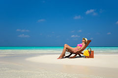 Young girl lying on a beach lounger Stock Images