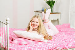 Young girl lying on the bed Royalty Free Stock Image