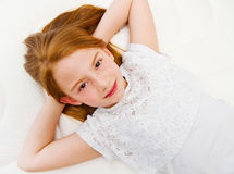 A Young girl is lying on the bed. Quality mattress. Stock Photos