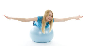Young girl lying on blue ball Royalty Free Stock Images